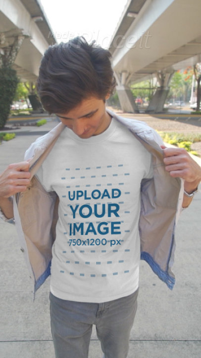 Video of a Young Man Showing off His T-Shirt in the Street 3605v