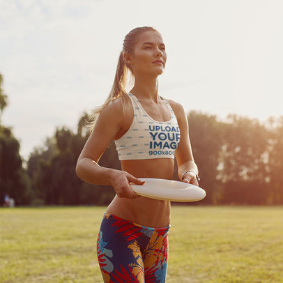 Sports Bra Mockup of a Woman with a Frisbee-Style Flying Disc M10218-r-el2