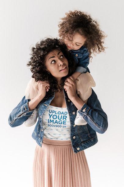 Tee Mockup Featuring a Curly-Haired Woman Carrying Her Daughter on Her Shoulders m6145-r-el2