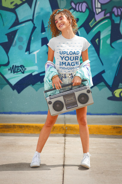 80's-Themed T-Shirt Mockup of a Young Woman Holding a Boombox m11592