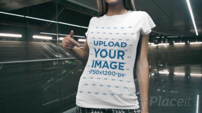 T-Shirt Video of a Playful Woman Posing Inside a Modern Building 3473v