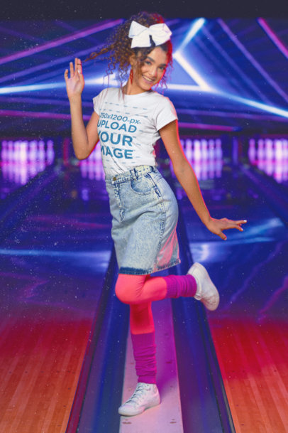 T-Shirt Mockup Featuring a Woman in an 80s Outfit Posing At a Bowling Alley m11595