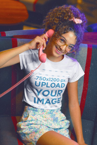T-Shirt Mockup of a Woman with an 80's Outfit Using a Retro Telephone M11599
