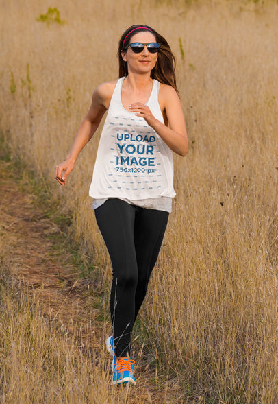 Mockup of a Woman Running in a Field While Wearing a Tank Top M6581-r-el2