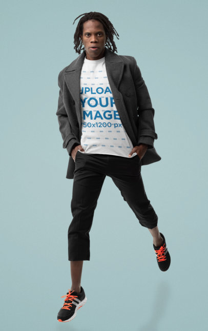 T-Shirt Mockup of a Fashionable Man Doing a Small Jump M10771