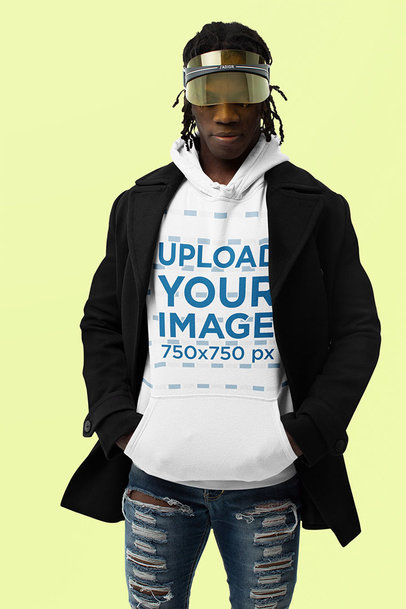 Mockup of a Fashionable Man Wearing a Hoodie in a Studio m10779