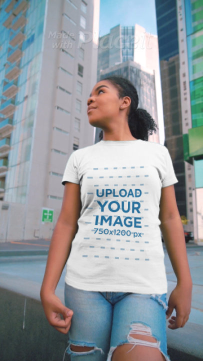T-Shirt Video Featuring a Curly-Haired Woman in the City 3598v