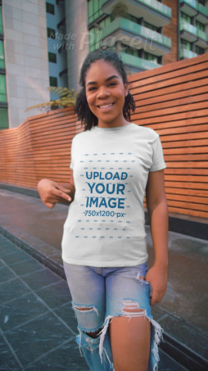 T-Shirt Video of a Smiling Woman Doing a Peace Sign Gesture 3599v