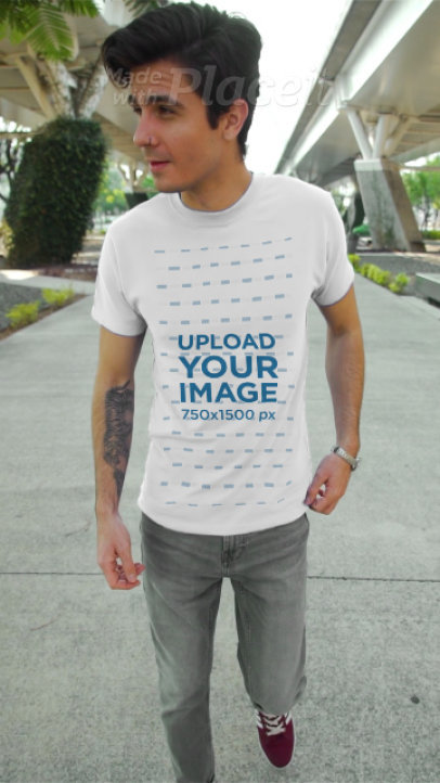 T-Shirt Video of a Man with a Forearm Tattoo 3611v