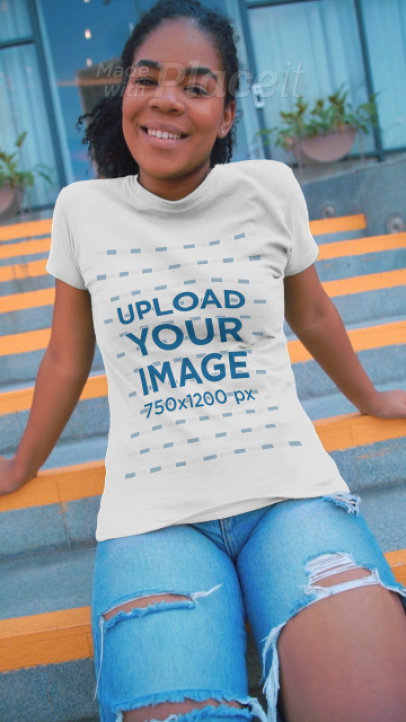 T-Shirt Video Featuring a Young Woman Posing in an Urban Setting 3597v