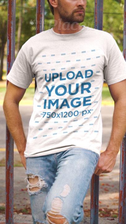 T-Shirt Video of a Man Posing by an Urban Fence 3644v