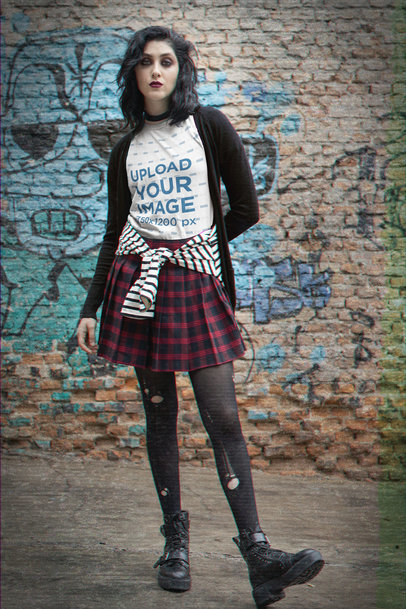 Grunge-Styled T-Shirt Mockup Featuring a Serious Woman Against a Brick Wall m12550