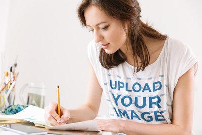 T-Shirt Mockup of a Woman Writing Down Notes 39956-r-el2