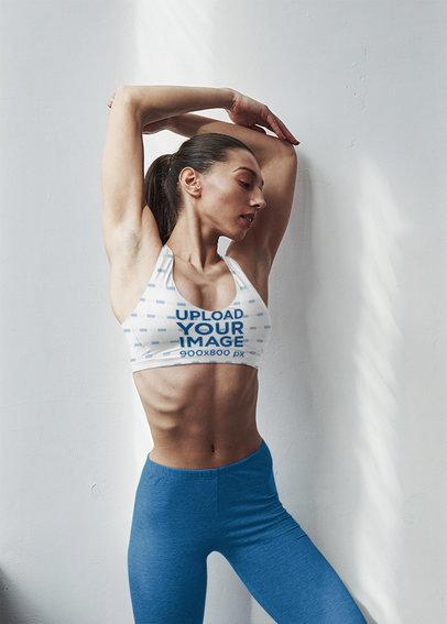 Sports Bra Mockup of a Woman Stretching Her Shoulders m7516-r-el2