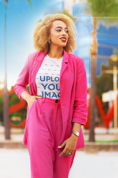 T-Shirt Mockup Featuring a Stylish Woman in an 80s Outfit Walking Down the Street m12035