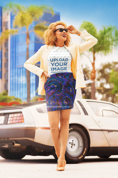 Tee Mockup of a Woman in a Miami Vice-Inspired Outfit by a Retro Car m12021