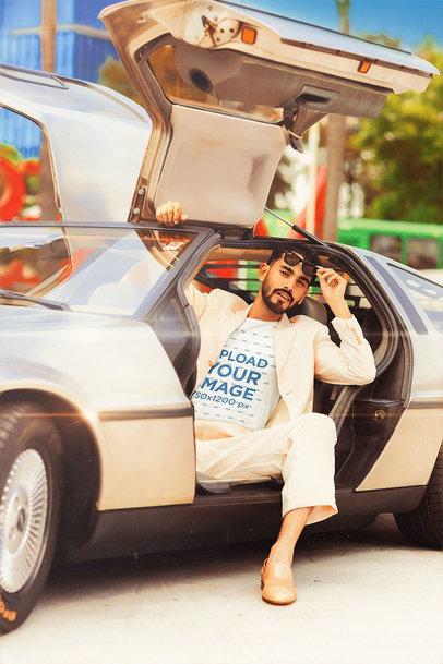 T-Shirt Mockup of a Stylish Man in a Retro Gull-Wings Doors Car m12025
