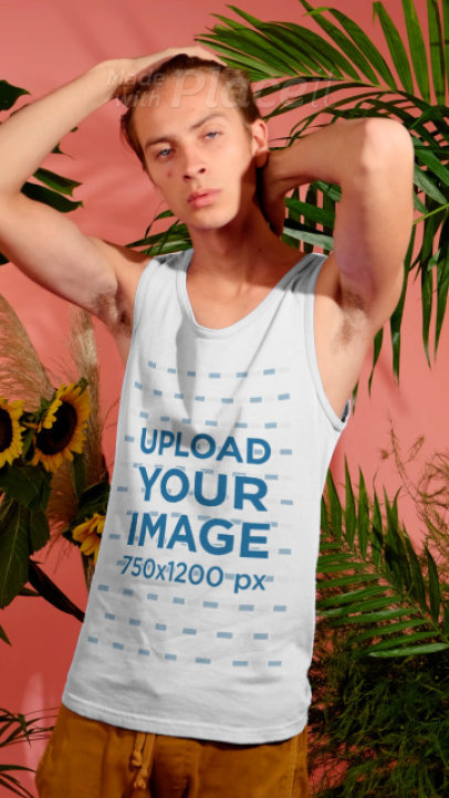 Tank Top Video Featuring a Young Man Surrounded by Tropical Plants and Sunflowers 3739v