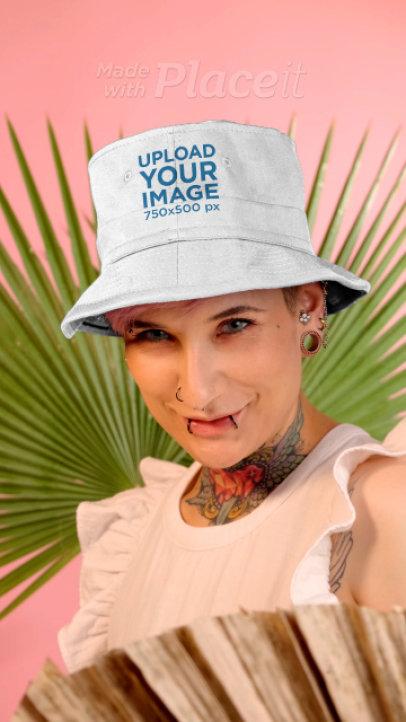 Video of a Tattooed Woman Wearing Bucket Hat in a Studio 3892v