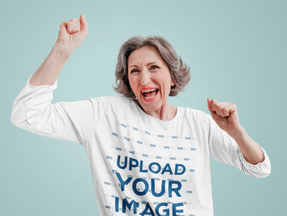 3/4 Sleeve Tee Mockup of a Senior Woman Celebrating m12719-r-el2