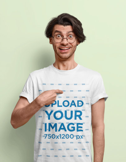 T-Shirt Mockup Featuring a Surprised Man In a Studio m3586-r-el2