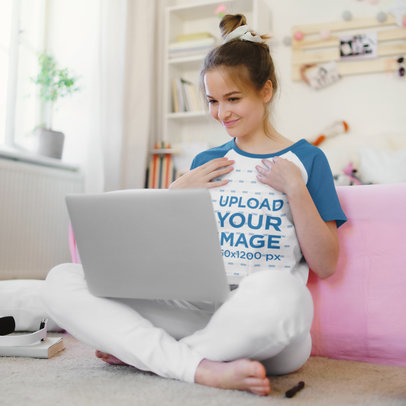 Mockup of a Young Woman Wearing a Raglan Tee While Having a Video Conference m13281-r-el2