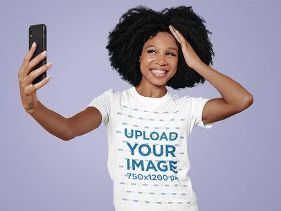 T-Shirt Mockup of a Happy Woman Taking a Selfie at a Studio m12678-r-el2