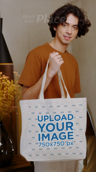 Video of a Young Man Holding a Customizable Tote Bag 4000v