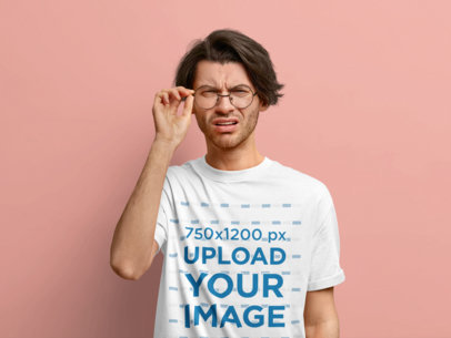 T-Shirt Mockup of a Confused Man With Glasses in a Studio m3659-r-el2