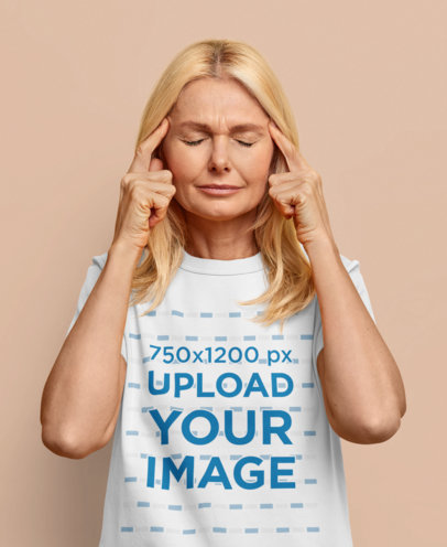 T-Shirt Mockup of a Thoughtful Middle-Aged Woman in a Studio m3660-r-el2