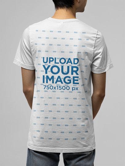 Back-View Mockup of a Man Wearing a Bella Canvas T-Shirt m13921