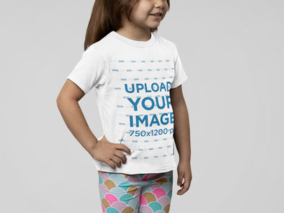 Round-Neck Tee Mockup Featuring a Little Girl Posing at a Studio M14940