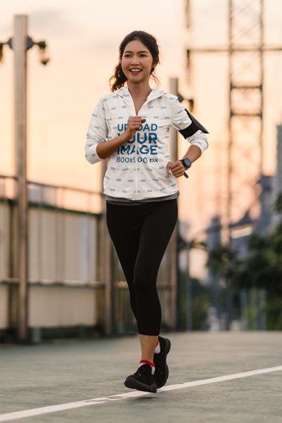 Full-Zip Hoodie Mockup Featuring a Woman Jogging on the Street m9350-r-el2