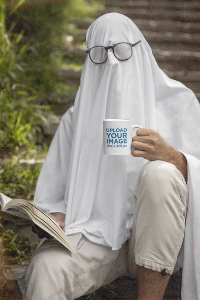Coffee Mug Mockup Featuring a Ghost Reading a Book m16641
