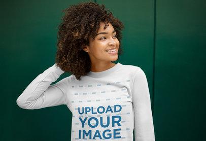Sweatshirt Mockup Featuring a Joyful Young Woman Against a Green Wall m16886-r-el2