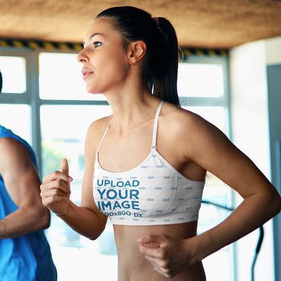 Sports Bra Mockup Featuring a Woman Running on a Treadmill m16975-r-el2