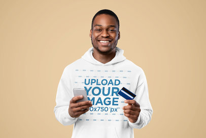 Hoodie Mockup of a Happy Man Holding a Credit Card and a Cellphone m16451-r-el2