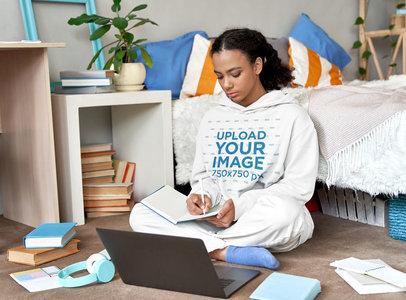 Pullover Hoodie Mockup of a Woman Taking Notes in Her Bedroom M9735-r-el2