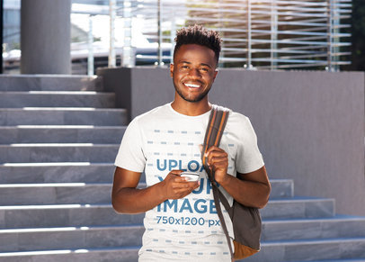 Transparent Mockup of a Man with a Basic Tee Posing Outside of College 40199-r-el2