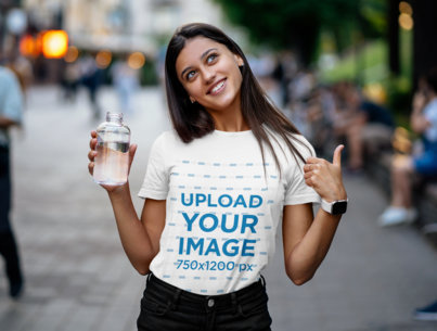 Transparent T-Shirt Mockup Featuring a Happy Young Woman Holding a Bottle of Water 41380-r-el2