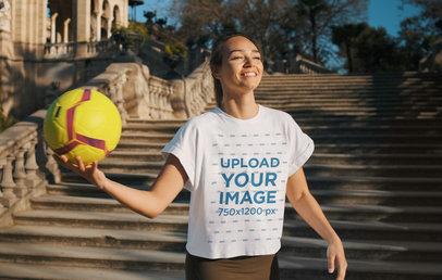 Transparent T-Shirt Mockup Featuring a Happy Woman Holding a Soccer Ball 42034-r-el2
