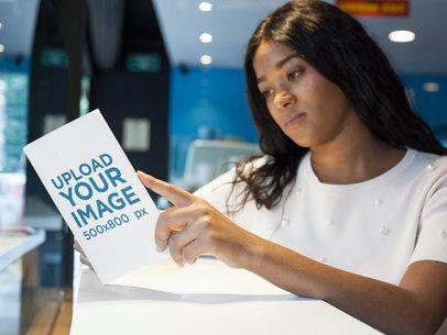 Pretty Black Girl Reading a Book Mockup Alone a17330