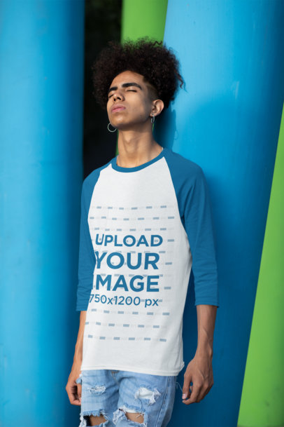 Transparent Three-Quarter Sleeves Raglan Tee Mockup Featuring a Young Man Leaning Against a Colorful Column 30221
