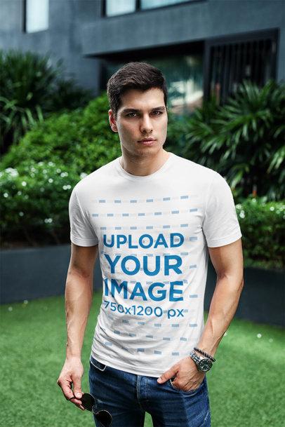 Transparent T-Shirt Mockup Featuring a Stylish Man Posing at a City Garden 433-el