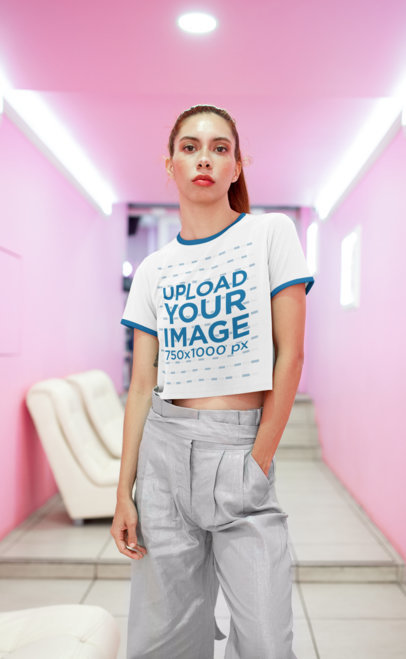Transparent Crop Top Ringer Tee Mockup Featuring a Freckled Woman in a Pink Hall 27257