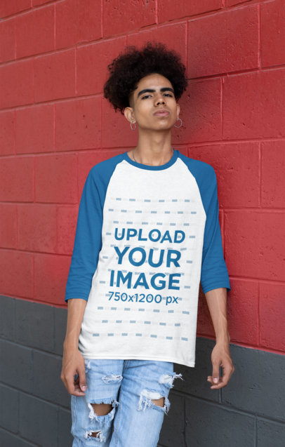 Transparent Mockup of a Man Wearing a Raglan Shirt with Three-Quarter Sleeves Leaning on a Wall 30227