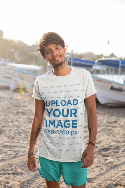 Transparent T-Shirt Mockup of a Slim Tattooed Man at the Beach  26751
