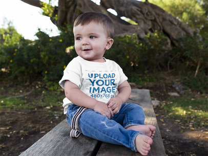 Transparent Cute Baby Boy Sitting Down in a Wooden Bench while Wearing a Round Neck Tshirt Template a16088