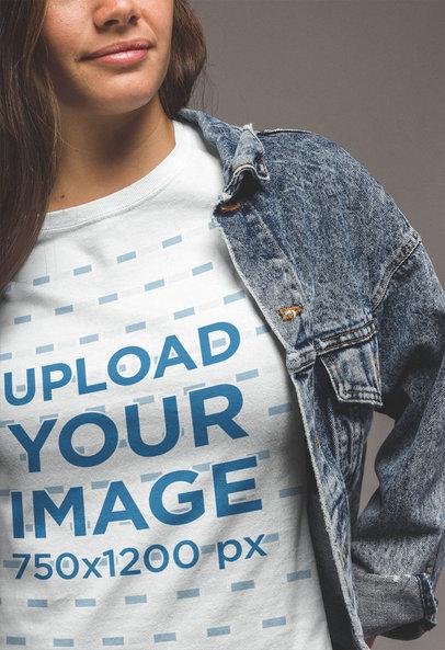 Transparent Close-Up T-Shirt Mockup of a Woman Wearing a Denim Jacket a20863