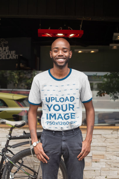 Transparent Ringer T-Shirt Mockup of a Smiling Man Standing on the Sidewalk 27908